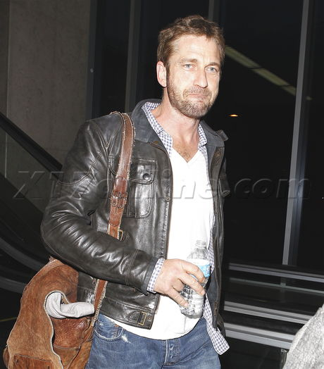 lax airport Gerard Butler jeans leather jacket