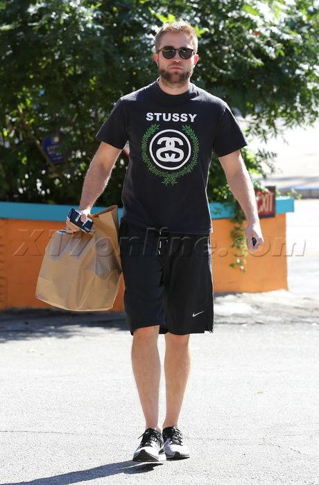 Robert Pattinson  sunglasses stussy shorts beard