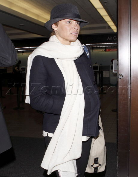 Pamela Anderson scarf pixie boots fashion baywatch lax airport
